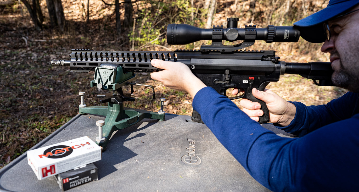 the author shooting a 6.5 creedmoor rifle with a muzzle brake at the range
