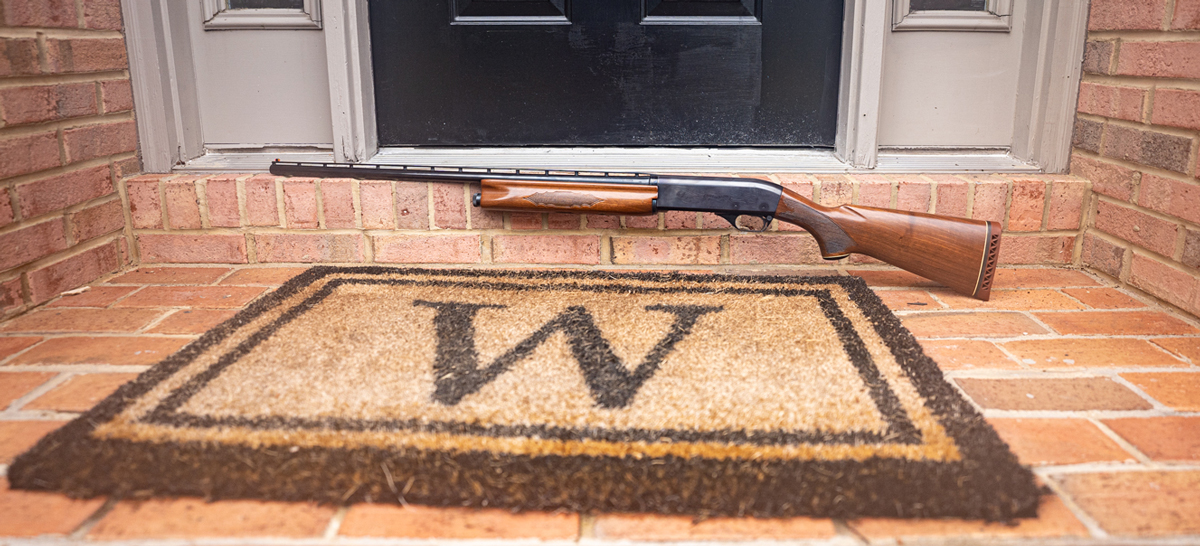 A shotgun at a front door of a home used for defense