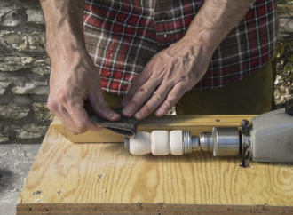 Sanding the barrel of a duck call