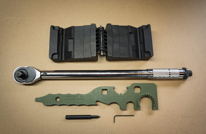 tools laid on a table that you'll need to change an AR-15 barrel