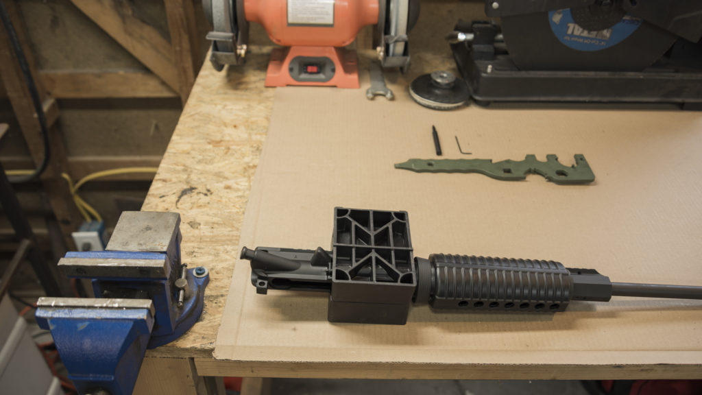 Placing the AR-15 barrel into a vice block