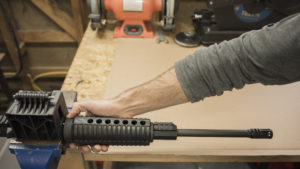 Secure the AR-15 upper receiver with barrel into a vice