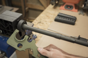 Using the armorer's tool to remove an AR-15 barrel
