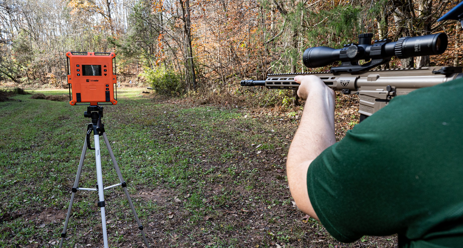 testing muzzle velocity with a chronograph at a shooting range