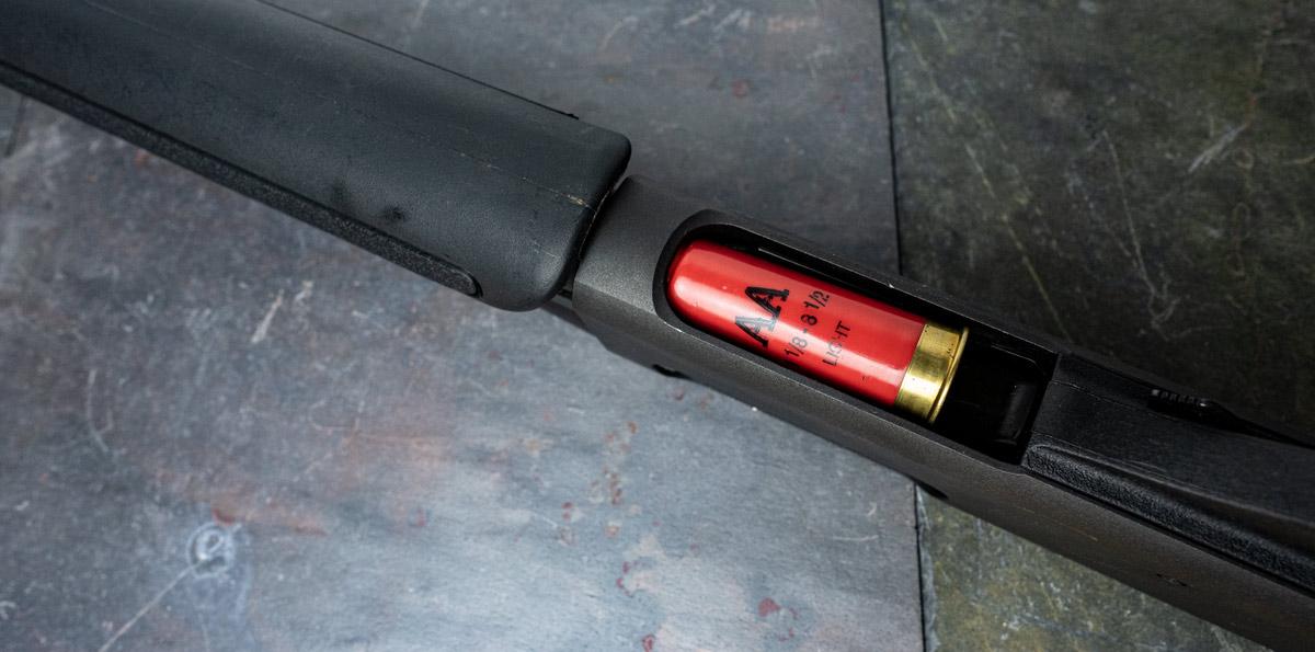 The tube magazine on a 12 gauge Remington shotgun
