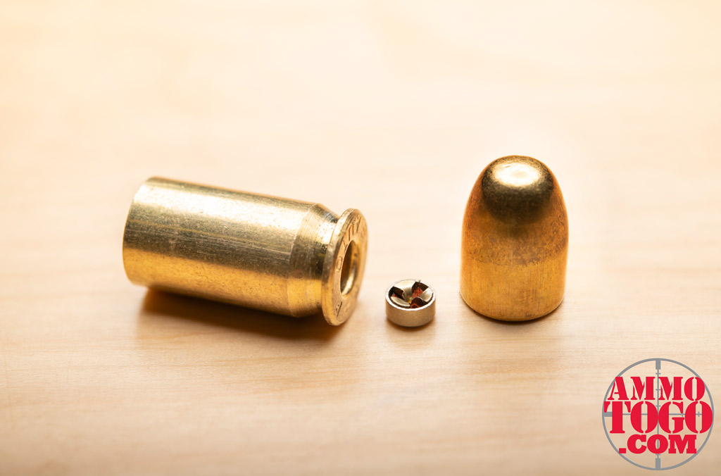A photo of a dissembled FMJ 9mm bullet showing the basic parts of ammunition