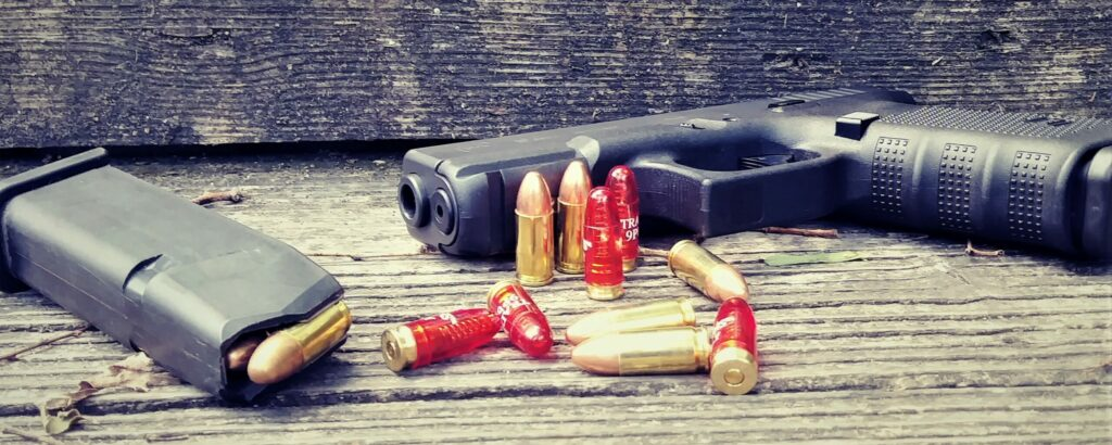 Ammunition along with a pistol on a shooting bench