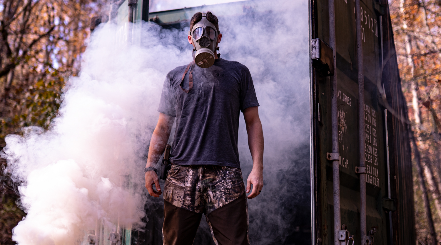 smoke all around author wearing a gas mask