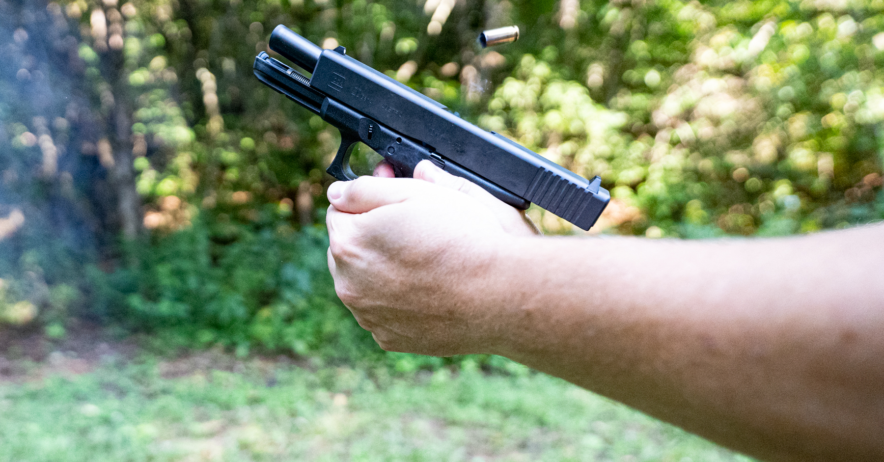 A pistol's recoil demonstrated at a shooting range