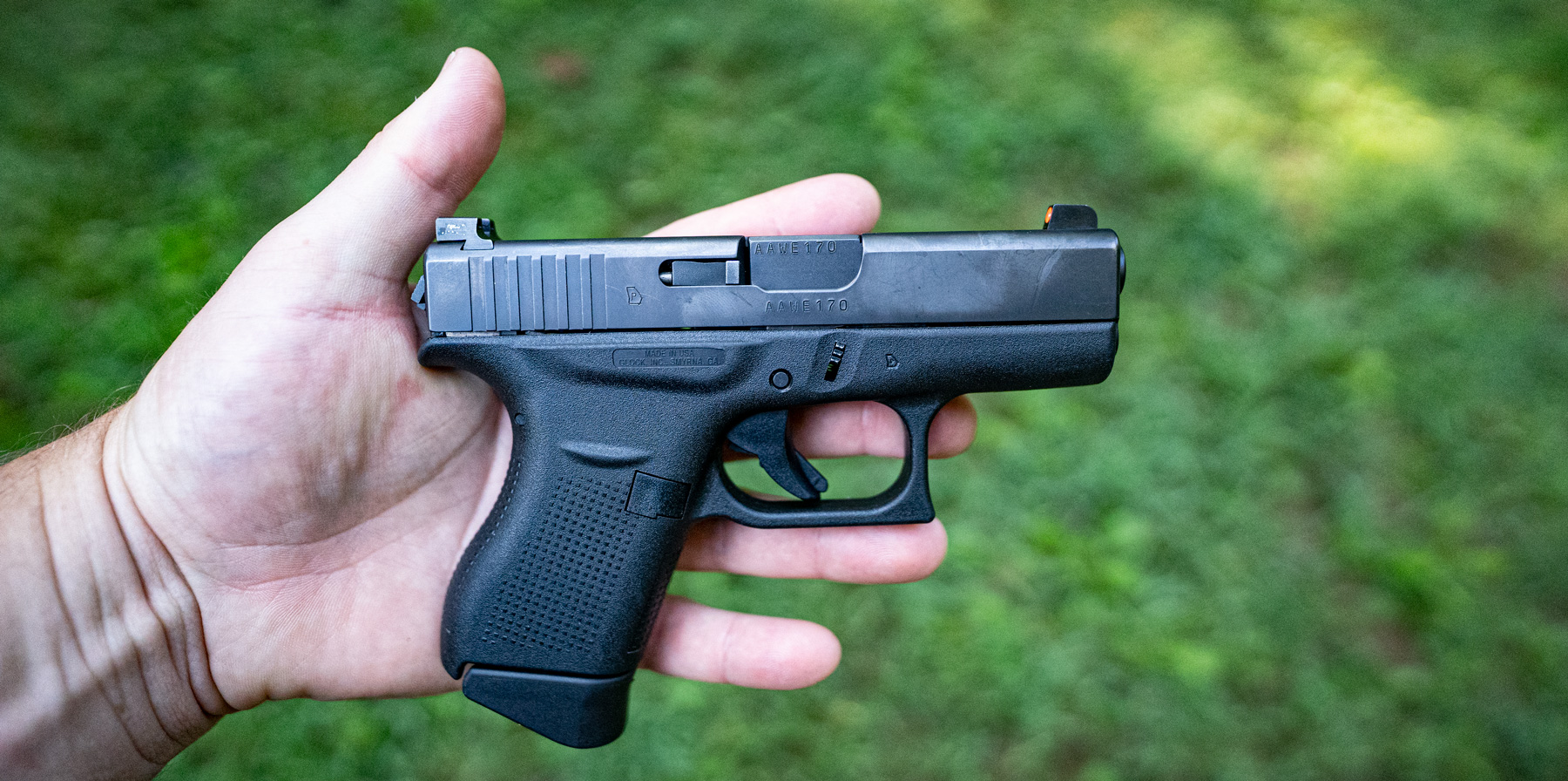 The Glock 42 held by a shooter in this photo is a popular concealed carry gun.