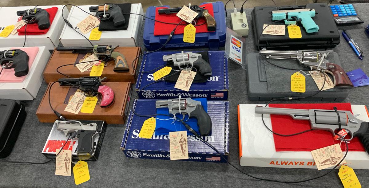guns for sale at a gun show