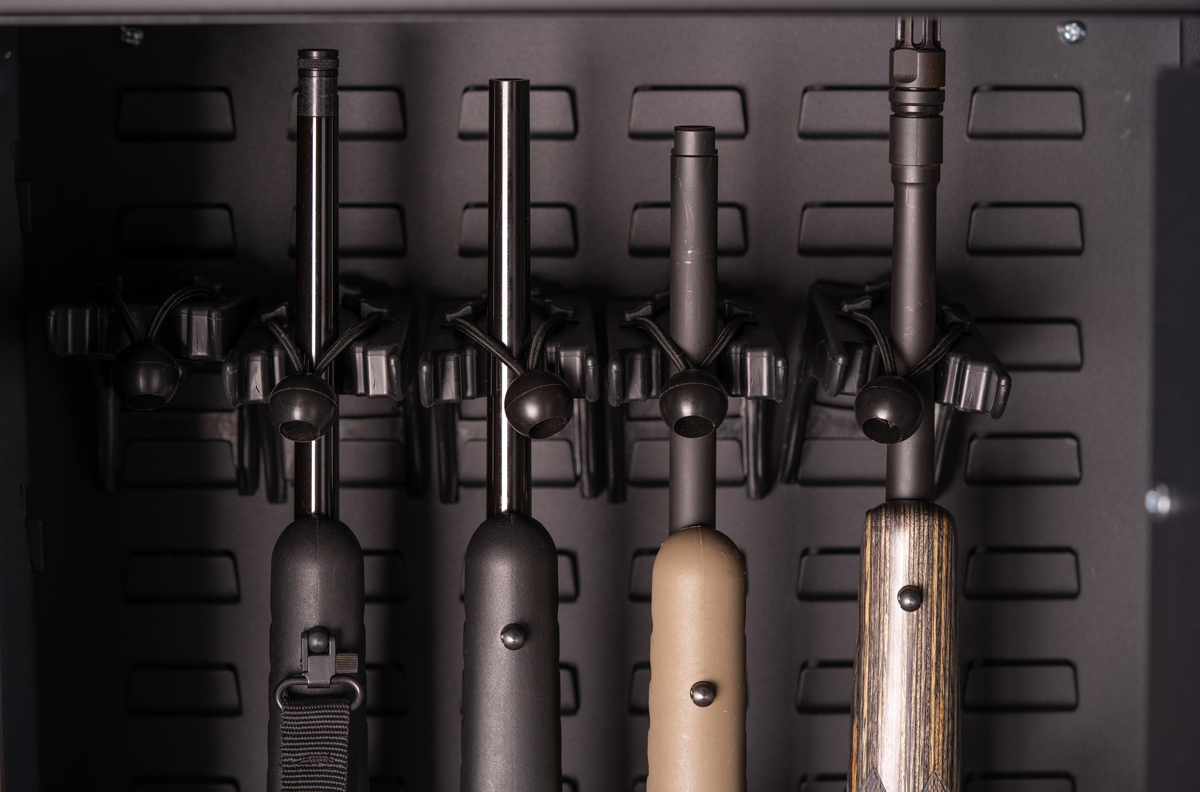 rifles in a safe lined up showing benefits of a gun trust