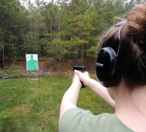 Woman shooting a handgun
