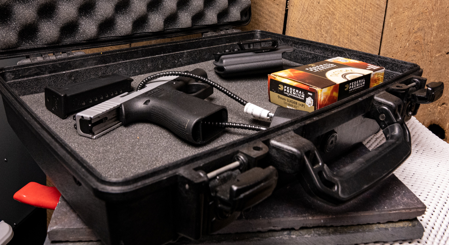 hard sided case with locked gun and ammo inside