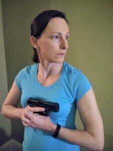 The author demonstrating center axis relock with a pistol