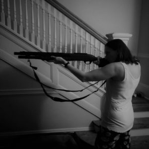 the author with a shotgun in her home