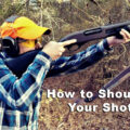 Demonstrating the correct way to shoulder a shotgun
