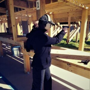 The author at the shooting range shooting with the center axis relock stance