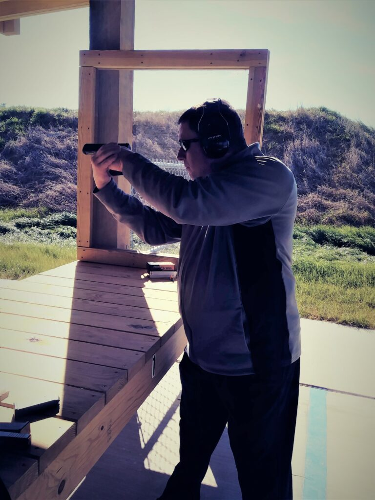 A left-handed shooter using center axis relock at the shooting range.