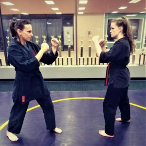 Demonstrating a martial arts stance and its similarity to the shooting stance