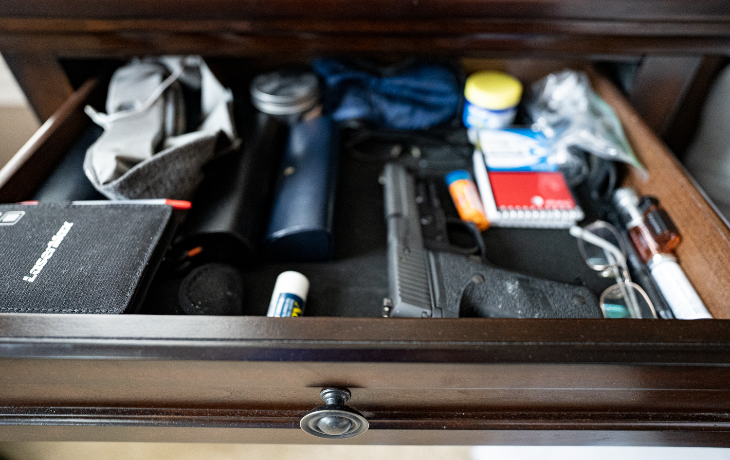 A pistol in a nightstand drawer