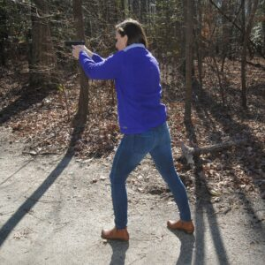 The author demonstrating the weaver stance at a shooting range